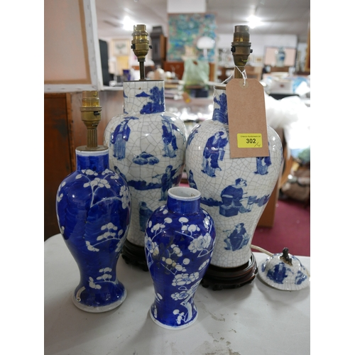 302 - Four 19th century Chinese blue and white porcelain vases, converted to lamps...