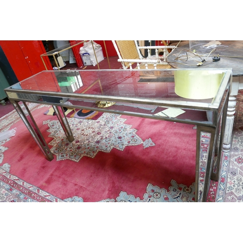 327 - A large mirrored console table, with bevelled mirrored top, sides and legs, H.78 W.155 D.41cm...