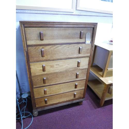 182 - An Art Deco oak chest of six drawers by Herbert Gibbs, H.120 W.175 D.43cm...