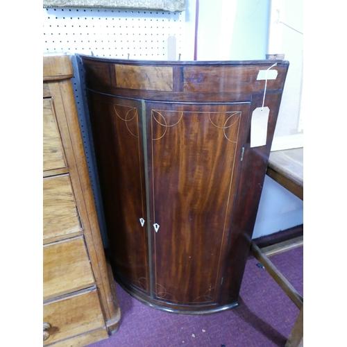 250 - A Georgian mahogany corner cabinet, with boxwood inlay and ivory escutcheons...