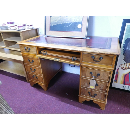 264 - A 20th century pedestal desk, with red leather skiver above central sliding shelf flanked by two sma...