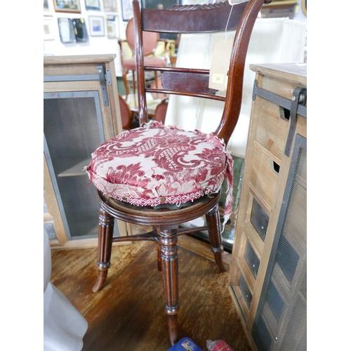 291 - A William IV mahogany music stool...