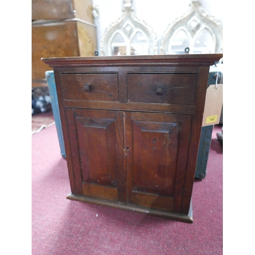 168 - A 19th century oak standing / hanging cabinet, two drawers over two shelves with doors, 55 x 46cm x ...