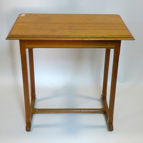 194 - An Arts and Crafts oak occasional table, H.77 W.79 D.52cm...