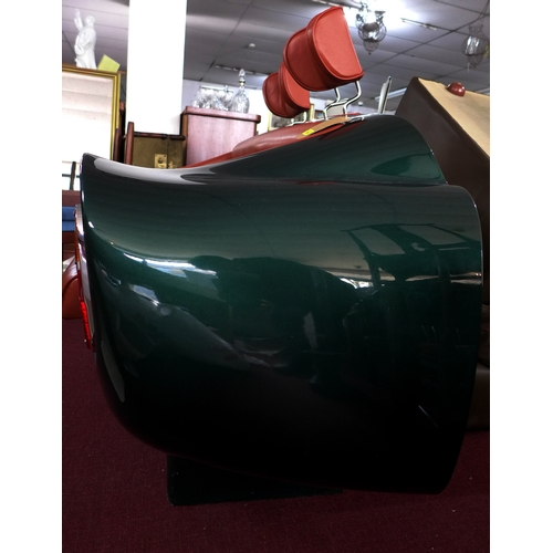 298 - An Aston Martin DB6 sofa with label for Superleggera...