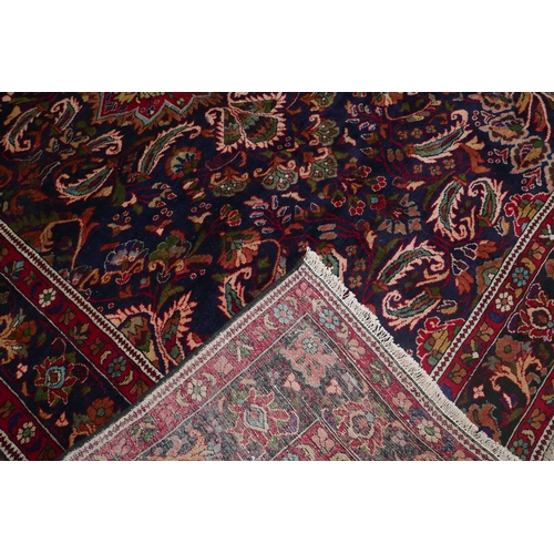 70 - A North West Persian Mahal carpet, central double pendent medallion with repeating spandrels on a sa...