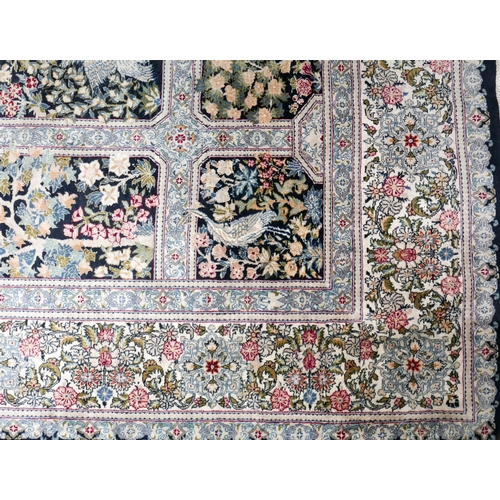 135 - A 20th century Persian carpet, with central floral medallion, surrounded by tiles having floral and ...