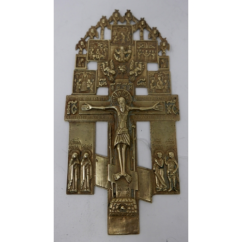 93 - A Russian polished brass icon depicting the crucifix with selected Biblical scenes above, having Cry...