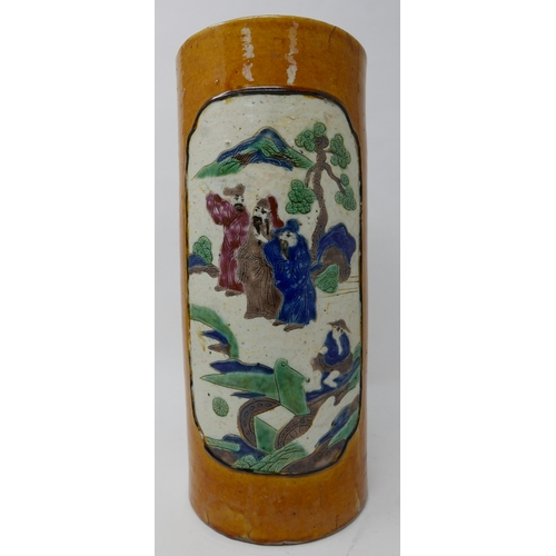 99 - A late 19th/early 20th century Chinese cylindrical brush pot holder depicting 2 panels of figures wi...