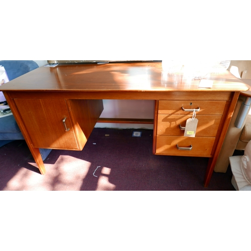 312 - A mid 20th century Gordon Russel mahogany desk, H.76 W.139 D.76cm, with original receipt from Heals ...