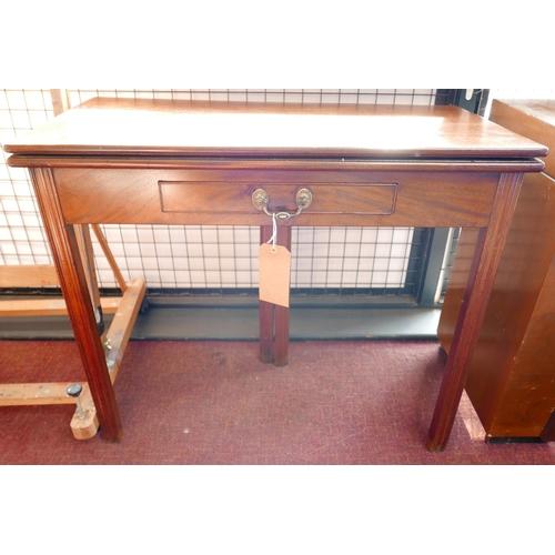 322 - A Georgian mahogany single drawer fold over tea table, H.72 W.85 D.43cm...