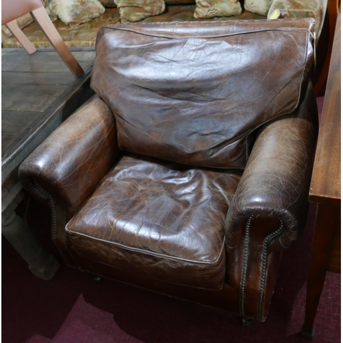 295 - A Howard style brown leather and stud bound armchair...