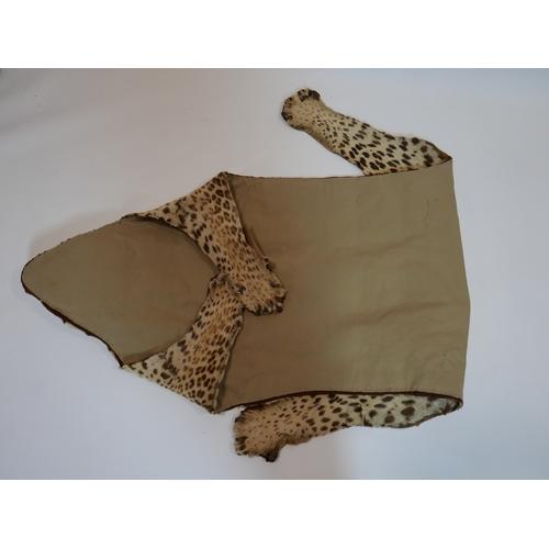 323 - A late 19th century full length leopard skin carpet, 230 x 135cm...