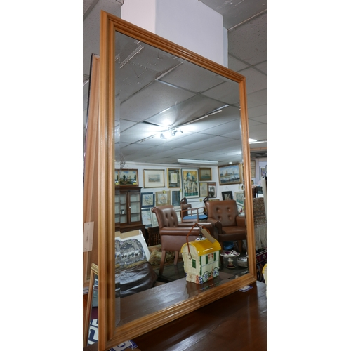 291 - A contemporary mirror with bevelled plate, 134 x 105cm...