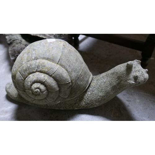 311 - A stone snail ornament, H.26 W.54 D.27cm...