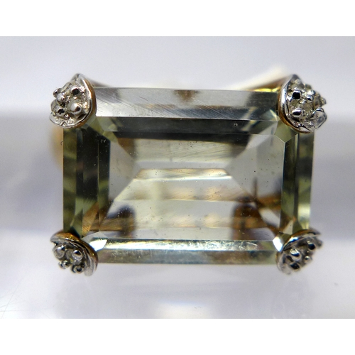58 - A 9ct yellow gold, diamond and green amethyst ring, centrally set with a large, stepped-cut icy gree...