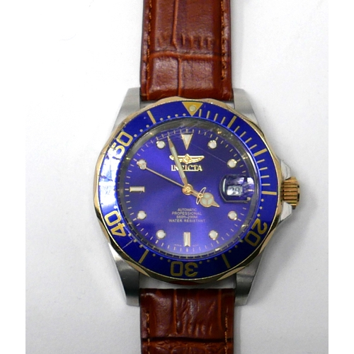 120 - A Gentleman's Invicta stainless steel and gilt metal wristwatch with navy blue dial and outer bezel,...