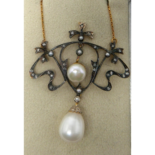 338 - A boxed yellow gold necklace, the whiplash frame set with diamonds and small pearls suspended by two...