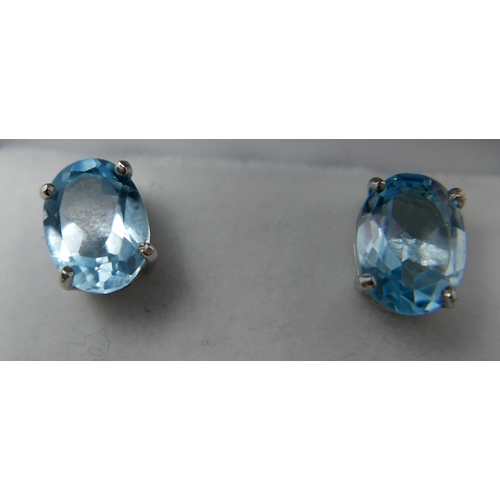 348 - A boxed pair of sterling silver and oval blue topaz stud earrings, 8 x 6mm, 1.6g....