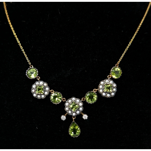 321 - A boxed yellow gold, diamond, seed pearl and peridot cluster necklace, L: 48cm, 6.7g...