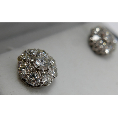 335 - A pair of platinum and 18ct white gold diamond cluster stud earrings (approx 2 carats total), each e...