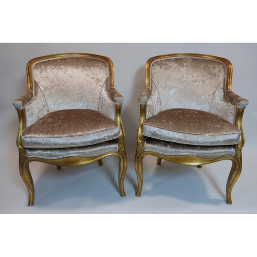 131 - A pair of Oficina Inglesa gilt wood chairs, with velour upholstery, raised on cabriole legs...