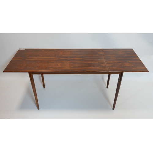 139 - A mid 20th century Danish exotic hardwood drop leaf table, with sliding top raised on tapered legs, ...