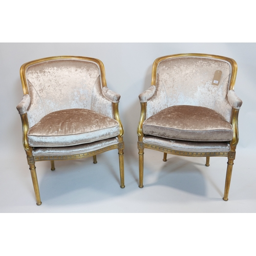 141 - A pair of Oficina Inglesa gilt wood chairs, with velour upholstery, raised on reeded tapered legs...