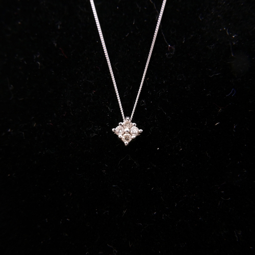 10 - A 10ct white gold and diamond pendant set with 4 stones on white gold chain, in box, 1 gram...