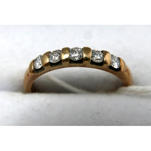 16 - A 9ct yellow gold ring set with five diamonds, 0.33 carats, 2.2 grams...