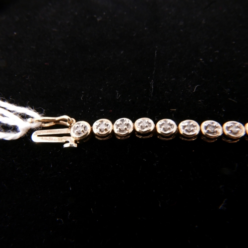 2 - A 9ct yellow gold and diamond tennis bracelet, 5.7grams...