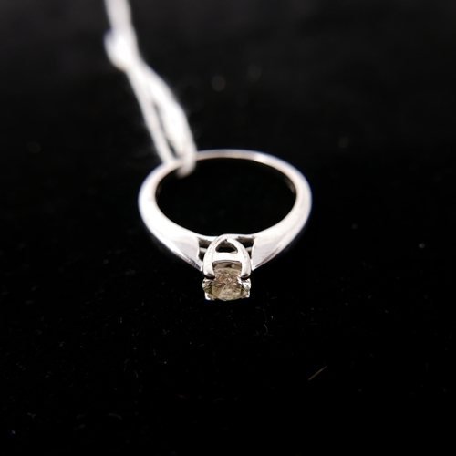 6 - A 9ct white gold solitaire diamond ring, in box, 0.25 carats...