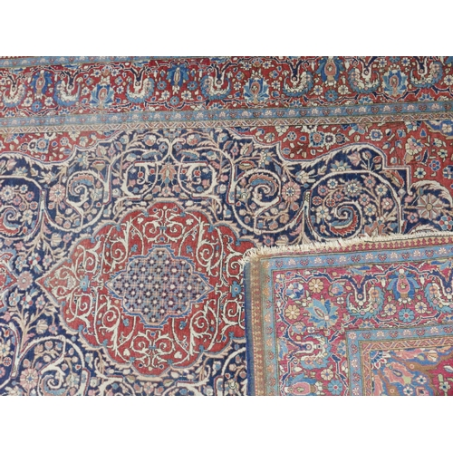 72 - A fine 20th century Kashan carpet, with central floral medallion, surrounded by floral swags and mot...