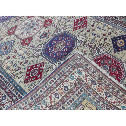 74 - A 20th century fine Ardabil carpet, with five geometric medallions surrounded by geometric motifs, o...