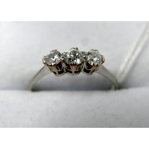 8 - A white metal ring set with three diamonds, in box, 2 grams...