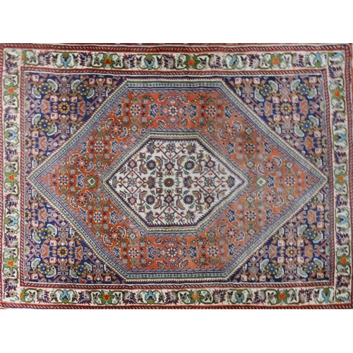 82 - A fine Bidjar rug with geometric floral motifs within double diamond medallion, on a red,blue and be...