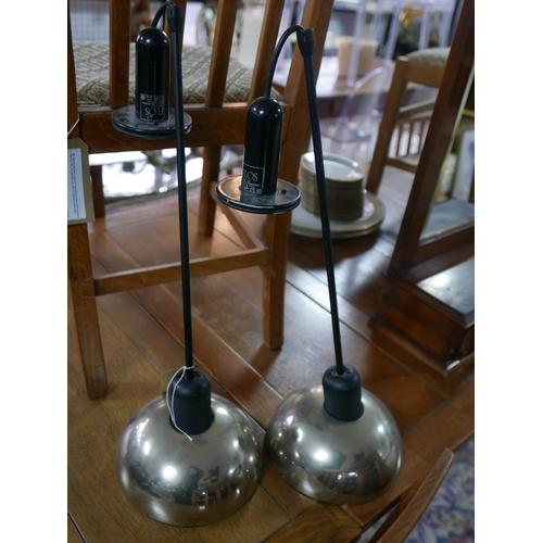 406 - A pair of Flos ceiling pendant lights, H.61cm (2)...