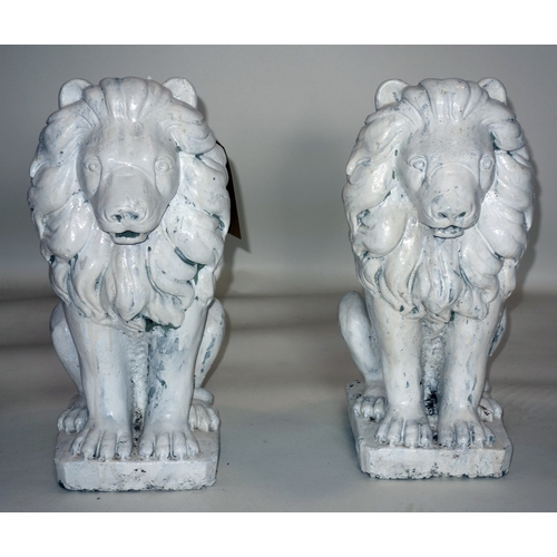 306 - A pair of white painted stone lions, H.45cm...