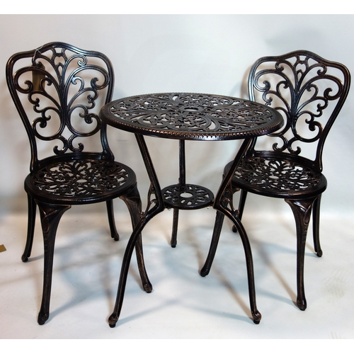 341 - A cast aluminum garden table and two chairs...