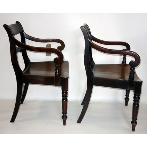 343 - A pair of Regency mahogany scroll armchairs...