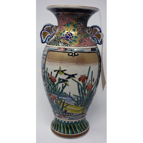 73 - A 19th century Japanese satsuma vase, decorated with flora and fauna, with green character marks to ...