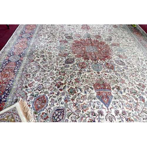100 - A large 20th century Kerman carpet with Sheik Safi design, on a beige, red and blue ground, floral b...