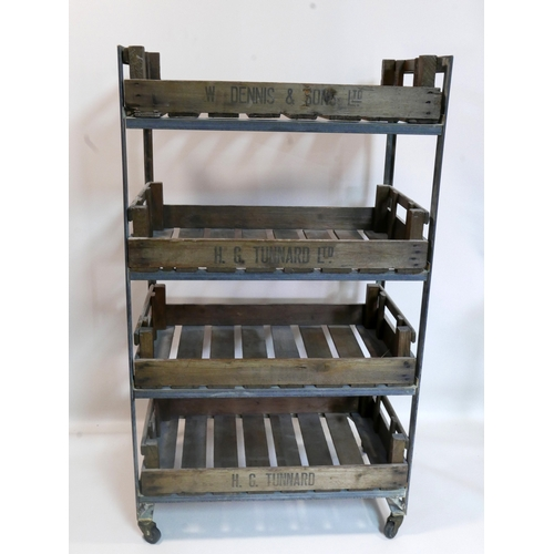419 - An industrial 4 tier trolley with removable wooden crates, raised on castors, H.136 W.77 D.46cm...