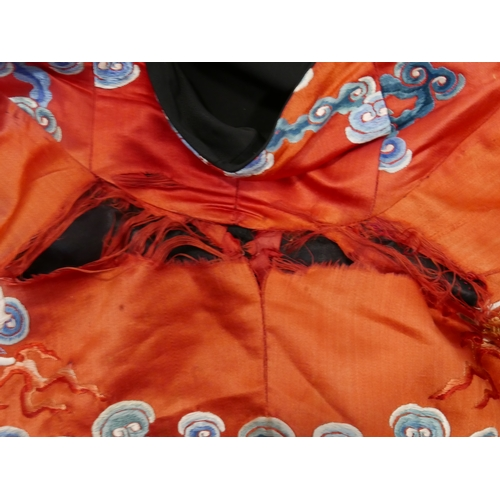 7 - A Chinese late Qing dynasty silk robe, c.1880/90, decorated with dragons chasing flaming pearls, amo...