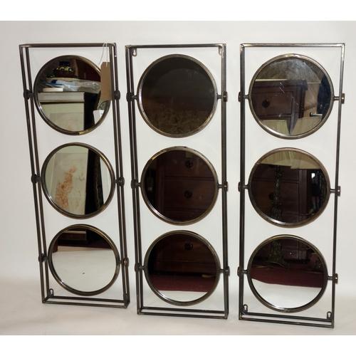 356 - Three contemporary wall mirrors, each having rectangular frame with three circular mirrors, 31 x 90c...