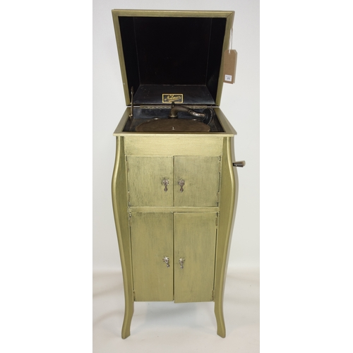 375 - A Nelmur gramophone in a gilt painted cabinet, H.101 W.43 D.46cm...