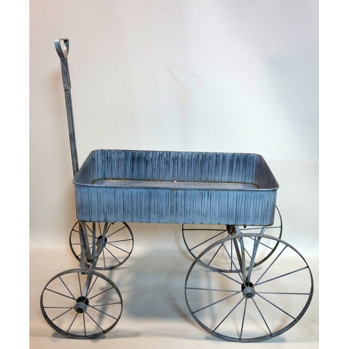 378 - A contemporary garden trolley, H.67 W.105 D.50cm...