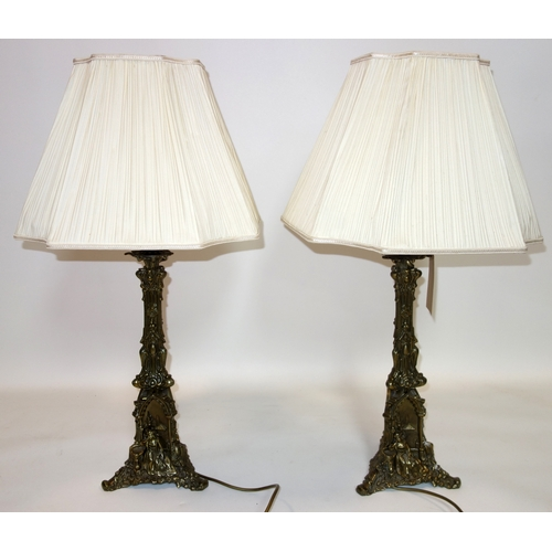 390 - A pair of early 20th century continental ormolu table lamps, with shades, H.50cm...