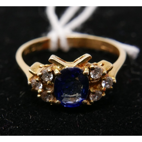 17 - An 18ct yellow gold, Ceylon sapphire (cornflower blue) and diamond ring, the central oval sapphire f...