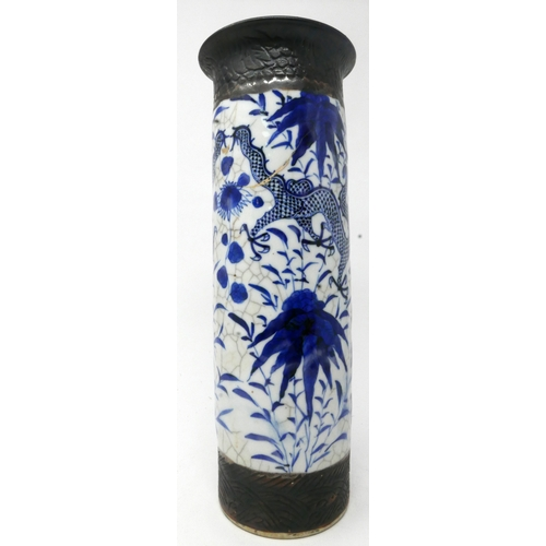 320 - A late 19th century Chinese blue and white cylindrical vase, decorated with dragons amongst stylised...